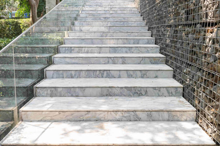 This photo shows a set of stairs which was installed with decorative concrete. This concrete mimics the look of marble.